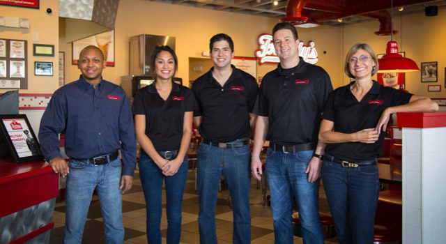 Group of happy Freddy's franchisees