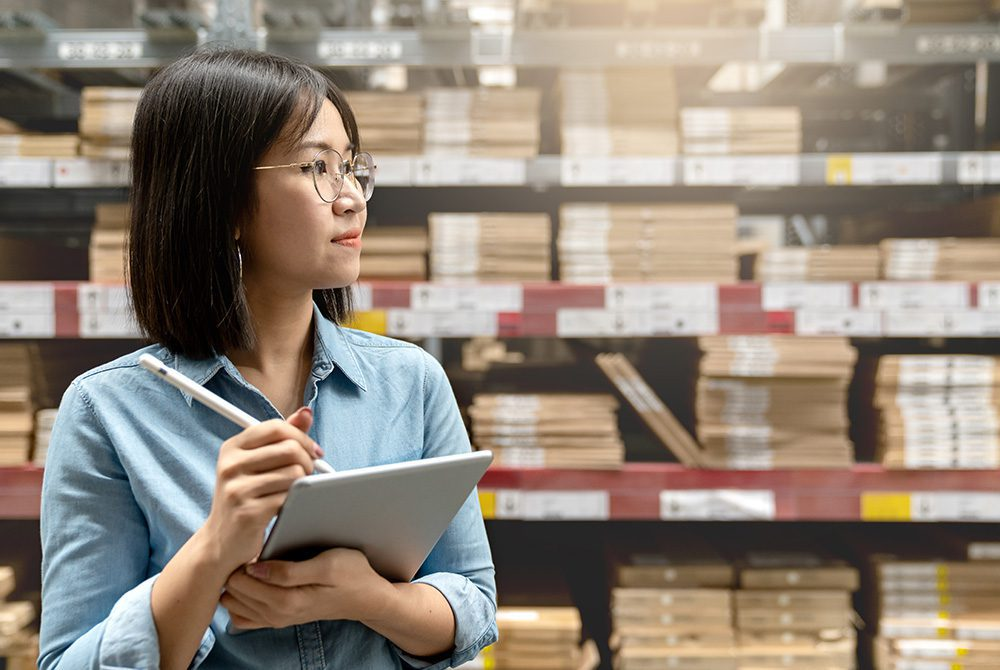 Woman taking inventory of stock