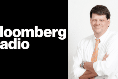Bloomberg Radio logo split screen with Charles Watson headshot