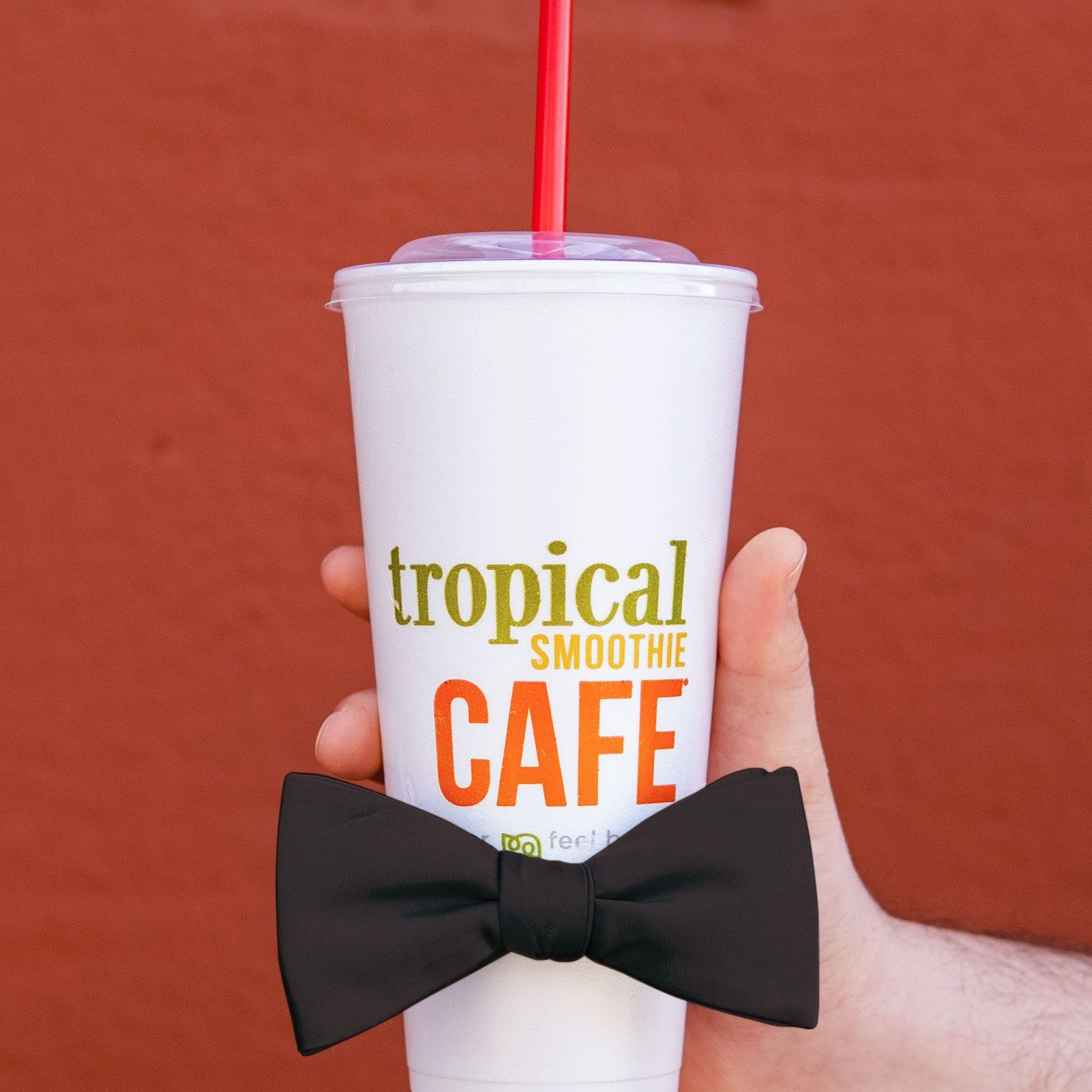 tropical smoothie cafe cup with a black bow tie