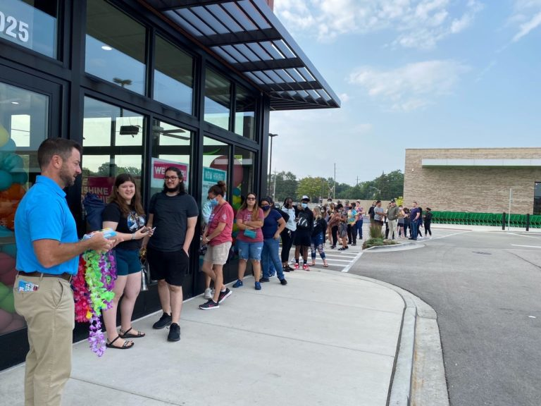 Guests waiting in line for a free smoothie at Grand Opening