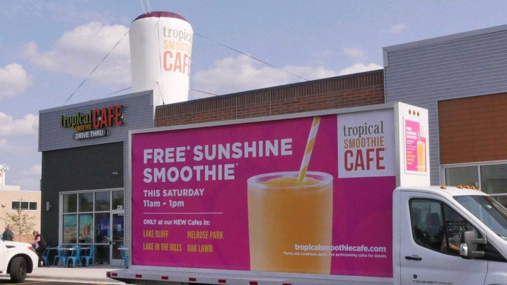 Free Sunshine Smoothie sign at Grand Opening that