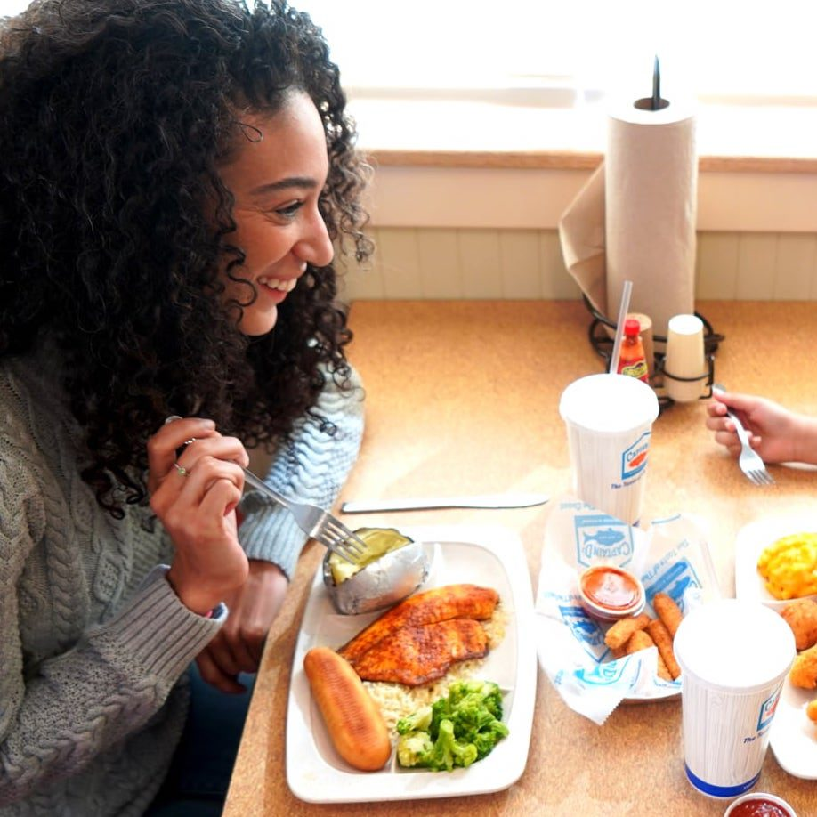 Happy customer dining at a Captain D's franchise
